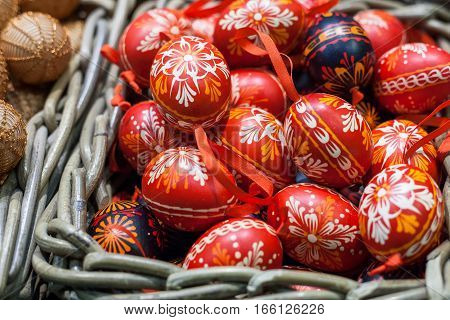 Many Easter eggs lie in the form of toys in the basket. Celebratory background.