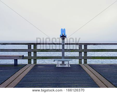 Seaside Telescope . Autumn Misty Morning On Wooden Pier Above Sea