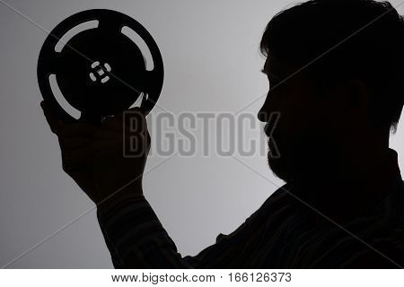 Silhouette Of A Bearded Man Looks At 16Mm