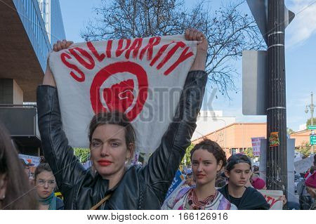 Woman Holding Sign About Solidarity