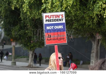 Woman Holding Sign About Russian President