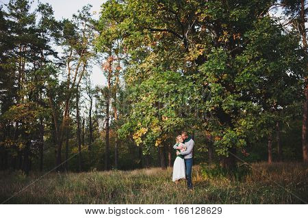 stylish couple in love on the big tree