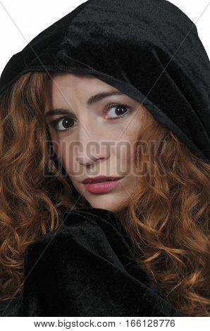 Beautiful woman wearing a long black cloak