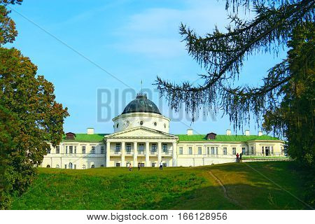 beautiful view to Kachanivka Palace with great architectural ensemble among branches