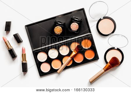 decorative cosmetics nude on white background top view.