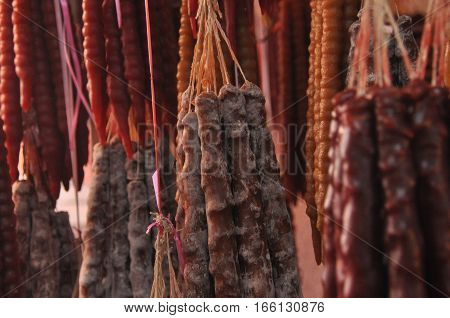 Czurczukela. Traditional Georgian delicacy reminiscent of the candy bar. The pods hanging on the bazaar.