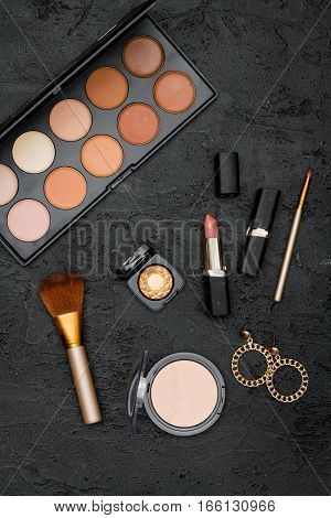 decorative cosmetics nude on dark background top view.
