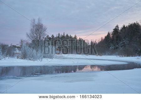 Cold winter sunset view of Zapadnaya Dvina (Daugava) river near Okhvat lake Penovskiy district Tver oblast Russia