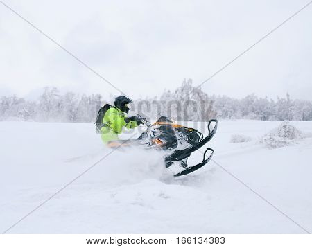 Athlete On A Snowmobile Moving In The Forest