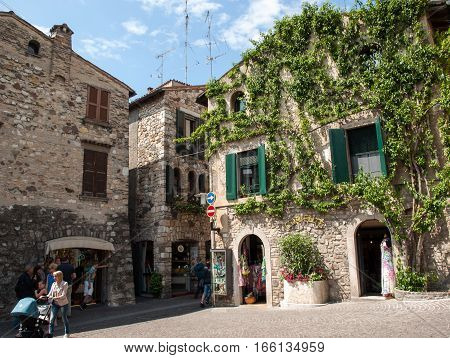 SIRMIONE, ITALY - MAY 5, 2016: Old house covered by ivy in Sirmione on Garda Lake Italy