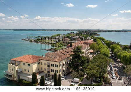 SIRMIONE, ITALY - MAY 5, 2016: View of colorful old buildings in Sirmione and Lake Garda from Scaliger castle wall Italy