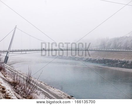 Bridge Over River In Winter