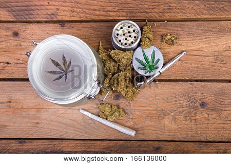Marijuana buds in glass jars with pipe