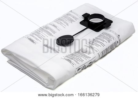 New dust bag for vacuum cleaner isolated on white background.