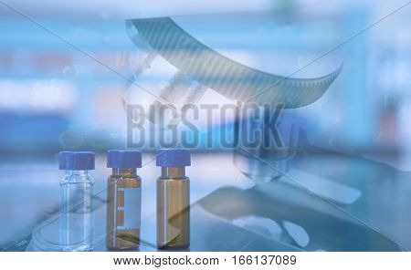 compond microscope and syringe in scientist hand in science labboratory background