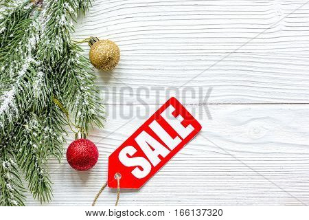 Christmas sales on wooden background top view.