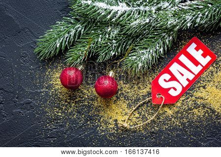Christmas sales on dark background top view.