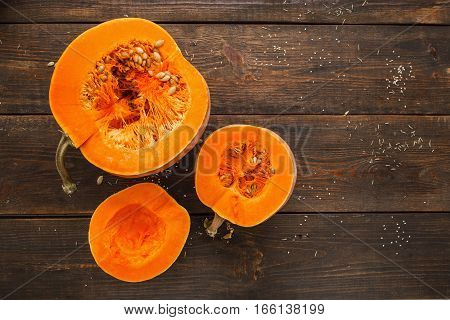 Set of orange pumpkins on wood flat lay free space. Fresh cut squashes on wooden table country autumn background. Seasonal harvest fall organic food dieting healthy food concept