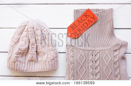 concept holiday sales of clothes and textiles top view on wooden background