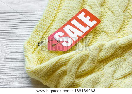 concept holiday sales of clothes and textiles on wooden background