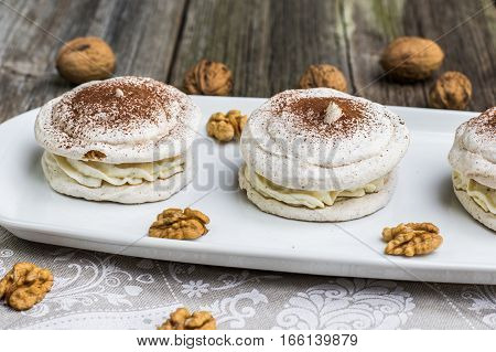 Detail On Walnuts Meringue With Cocoa With Cracking Walnuts