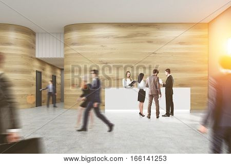 Busy office. People are walking entering doors in a corridor talking and discussing work issues. Wooden walls concrete floor. 3d rendering. Mock up. Toned image