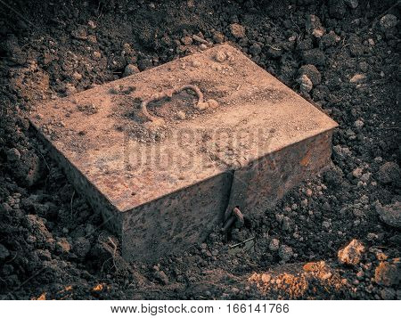 Old metal chest with the treasure found in the ground