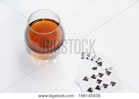 Abstract composition of drinking and playing cards. Isolated on white background.