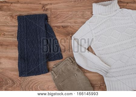 Winter Clothing Top View On Wooden