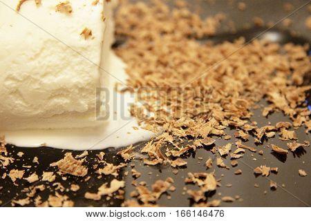 Chocolate Ice Cream And Hardered Chocolate Over