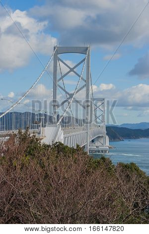 Great Naruto Bridge with blue sky background in cloudy day at Tokushima, Japan.