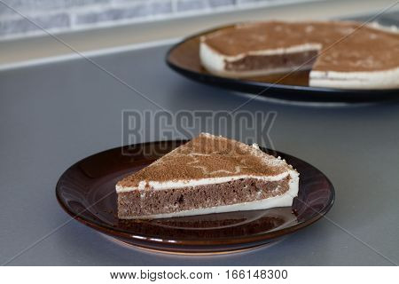 Piece of Christmas coffee cake with creamy souffle decorated star.