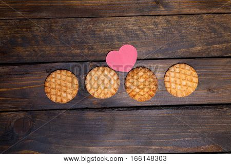 Four Round Cookies And Pink Heart Made Of Paper