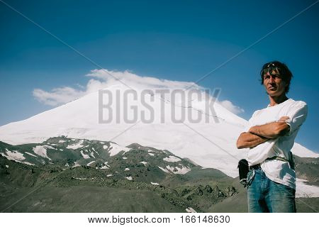 Man on the background traveler Elbrus. Concept Mountaineering Travel Lifestyle