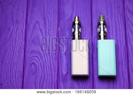 two e-cigarette (electronic cigarette vape) on the wood background