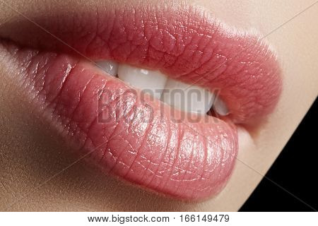Sweet kiss. Perfect natural lip makeup. Close up macro photo with beautiful female mouth. Plump full lips. Close-up face detail. Perfect clean skin light fresh lip make-up. Beautiful spa tender lip.