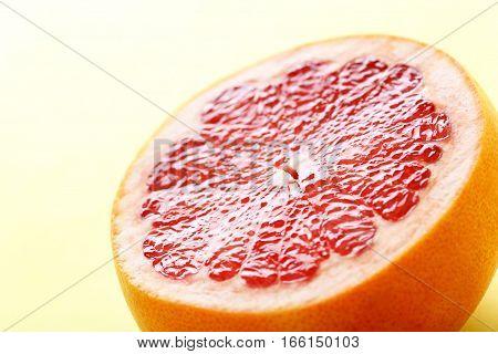 Sweet grapefruit fruit on a yellow background