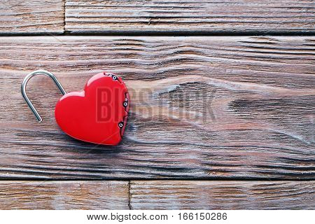Heart Shaped Padlock On Brown Wooden Table