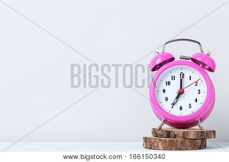 Pink Alarm Clock On White Wooden Table