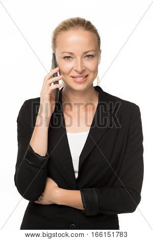 Beautiful young caucasian businesswoman wearing black business attire talking on mobile phone. Studio portrait shot on white background.