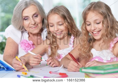 grandmother and her granddaughters spending time together