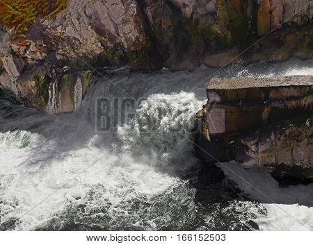 dam waterfall. Water cascade streaming down in a rainy season