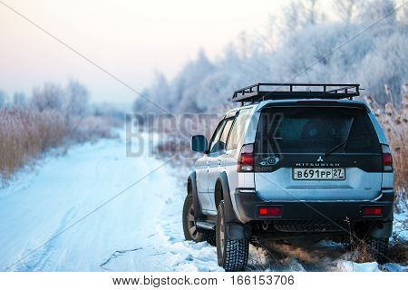 KHABEROVSK RUSSIA - JANUARY 5 2017: Mitsubishi Pajero Sport on a winrer road in early morning