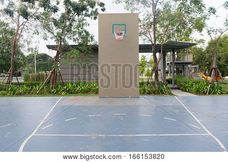 Basketball hoop on empty outdoor court at club house