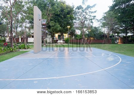 Empty mini outdoor basketball court in clubhouse