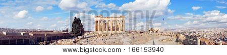ATHENS - SEPTEMBER 9:  People walk around the Parthenon on the Acropolis on summer sunny day on 9th of September, 2016 in the Athens.