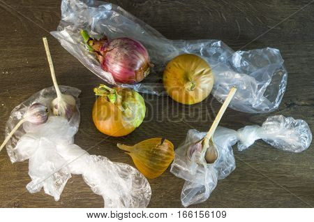 lie on the floor packs, garlic, onions. It is necessary to raise them.