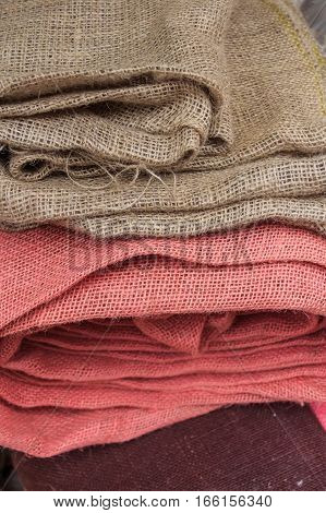 Close-up image of folded color burlap fabric
