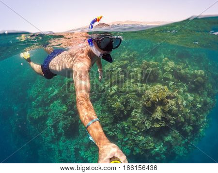 Snorkel Swims In Shallow Water, Red Sea, Egypt Safaga