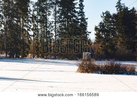 Winter Frozen Landscape With Hunting Tower On Highland